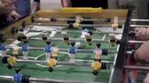 Handsome cheerful men having fun on event playing table soccer close up sport competition contest football Vidéos Libres De Droits