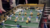 Handsome cheerful men having fun on event playing table soccer close up sport competition contest football 動画素材