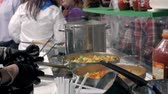 Hands of cook frying vegetables on pan colorfull color chef restaurant catering close up Vidéos Libres De Droits