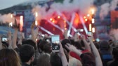 kabarık : Rear view of festival crowd raising their hands. Open air concert hip hop rap music students Stok Video