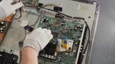 corriente electrica : Technician repairing a television. Hand with voltmeter above board with components. Repair of circuits electric equipment, close up