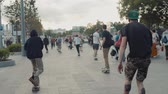 amateur : 21 June, Moscow, Russia, Go skateboarding day, crowd skaters, young professionals and amateur athlete boy is drive on skateboard, eco transportation, city streets, happy students drive on boards and longboards and doing tricks