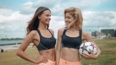 レッスン : Members Of Female High School Soccer Team, two fit sexy skinny womans portrait girls outdoor happy smiling ball football