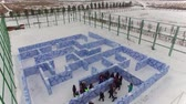 trenó : Little children play in the labyrinth in winter