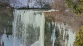 Zoom view of waterfall covered with icicles at the upper part of Tews Falls during the winter time.
