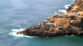 newfoundland : Aerial view of First in Newfoundland Lighting House, Canadian National Historical Site Fort Amherst, ruins of built in WWII bunkers for protection of St. John's Harbor from German U-boats Stock Footage