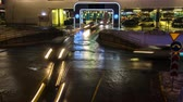 entrada da garagem : cars in queue at entrance in underground parking of hypermarket time lapse