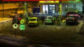 galão : Gasoline refueling station in cold winter night, time lapse