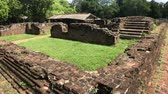 слон : Anuradhapura, Sri Lanka, side view of the wall and ruins of the Palace in the Royal Park 4K
