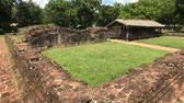 スリ·ランカ : Anuradhapura, Sri Lanka, left side view of the wall and ruins of the Palace in the Royal Park 4K 動画素材