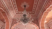krottenwijk : Jaipur, India - City Palace is a beautiful large chandelier against a rose ceiling 4K Stockvideo