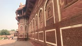 ассортимент : Agra, India, November 10, 2019, Agra Fort, tourists walk along the walls of the red brick structure 4K