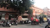 ассортимент : Jaipur, India - November 03, 2019: motorbike traffic along the road with tourists part 10 4K