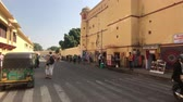 ассортимент : Jaipur, India - November 04, 2019: City Palace large groups of tourists move around the square part 5 4K