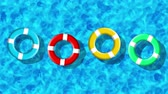 banho de sol : Summer Holiday At Swimming Pool With Inflatable Rings Floating On a Blue Water Surface