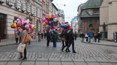 baloon : LVIV, UKRAINE - February 28, 2015 Busy street in center Lviv with sellers of baloons