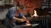 kowalstwo : artisan blacksmith working in the forge