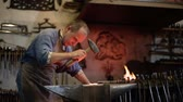 kowalstwo : blacksmith forges on the anvil, the hot metal