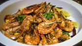 colesterol : Baked sea shrimp with lemon in a white dish at Thai restaurant
