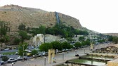 династия : Shiraz Historical Quran Gate in Scenic Surrounds with Busy Road and Waterfall