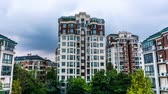urbane : Time Lapse Wuhu Anhui China Multi Level Apartment Building with Blue Sky Background Stock Footage