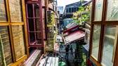 urbane : Time Lapse Old Shanghai Tianzifang District Open Window Building with Cloudy Rainy Sky Background