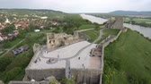 Словакия : Devin Castle Fortified Walls Rocks with Walking Tourists at the Courtyard and Breathtaking Picturesque Landscape Watchtower High Angle View Стоковые видеозаписи