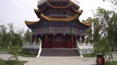 jade : Hotan Picturesque Kunlun Lake Park Low Angle Frontal View of Pagoda with Cloudy Blue Sky at Background Stock Footage