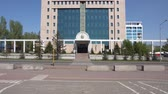 política : Nur-Sultan Astana Government Building of the Republic of Kazakhstan Frontal View on a Sunny Blue Sky Day