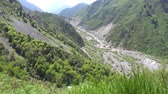landslide : Esik Lake Issyk Picturesque Breathtaking Landscape View of Mountains Rivers and Roads on a Sunny Blue Sky Day