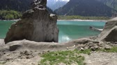 landslide : Esik Lake Issyk Picturesque Breathtaking Huge Rock View on a Blue Sky Day Stock Footage