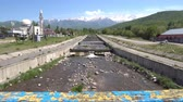 kazak : Esik Issyk River Streaming from the Snow Capped Mountains at the Central Mosque View on a Sunny Blue Sky Day Stok Video