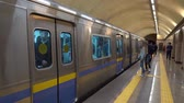 politika : Almaty Metro Subway Station Local People are Entering and Exiting the Train through Doors while a Police is Observing Them Dostupné videozáznamy