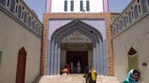 Sehwan Sharif Hazrat Laki Shah Sadar Shrine Entrance into the Main Tomb with Pilgrim on a Sunny Blue Sky Day