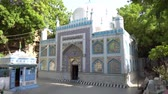 Hyderabad Sarfaraz Khan Kalhoro Shrine Side View with Surrounding Grave on a Sunny Blue Sky Day Videos