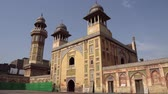 coran : Lahore Wazir Khan Mughal Era Mosque View of Minaret and Facade from the Courtyard on a Sunny Blue Sky Day