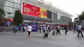 ulusal bayrağı : Shanghai Railway Station Nanchang South Square with People Walking during Golden Week Holiday National Day of Peoples Republic of China