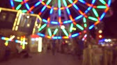 tekerlekler : Beautiful amusement park at night, ferris wheel and carousel,  defocused video. Stok Video