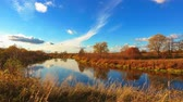 üzerinde : Timelapse of autumn landscapes, beautiful sky over river, 4k. Stok Video