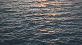 Slow motion, beautiful sunset over ocean, sun reflect in water. 4k pro res video.