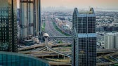 Time lapse of Dubai skyline and rush hour traffic in downtown Stock Footage