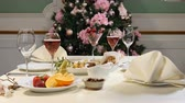 obrus : Restaurant concept. New Year and Merry Christmas feast table. Celebration table decoration.. Sliced fruit dish, cheese plate and champagne in glasses are beautifully served on celebration table Wideo