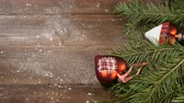 koflík na čaj : New Year and Merry Christmas 2019 2020. christmas tree with decorations on wooden background. Female hand puts a cup of freshbrewed coffee.