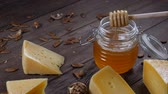 twaróg : Honey and cheese. Restaurant table serving. Hard cheese with nuts on wooden background
