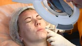 Close up of beautician and female client getting facial procedure. Modern cosmetology. lip augmentation. 4k Stock Footage