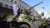 haki : KYIV, UKRAINE - AUGUST 23, 2018: an exhibition of modern weapons and military equipment.Children in the war machine.