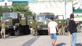 arsenal : KYIV, UKRAINE - AUGUST 23, 2018: an exhibition of modern weapons and military equipment.Soldiers near military trucks. Stock Footage