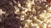 Fresh crispy popcorn drops in a bucket. Fresh hot popcorn drops in a bowl. 動画素材