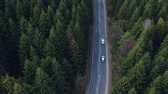 движение : Aerial view of the mountain road, at sunrise Стоковые видеозаписи
