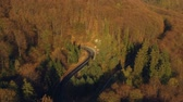 conduzir : Aerial view of the mountain road, at sunrise Stock Footage